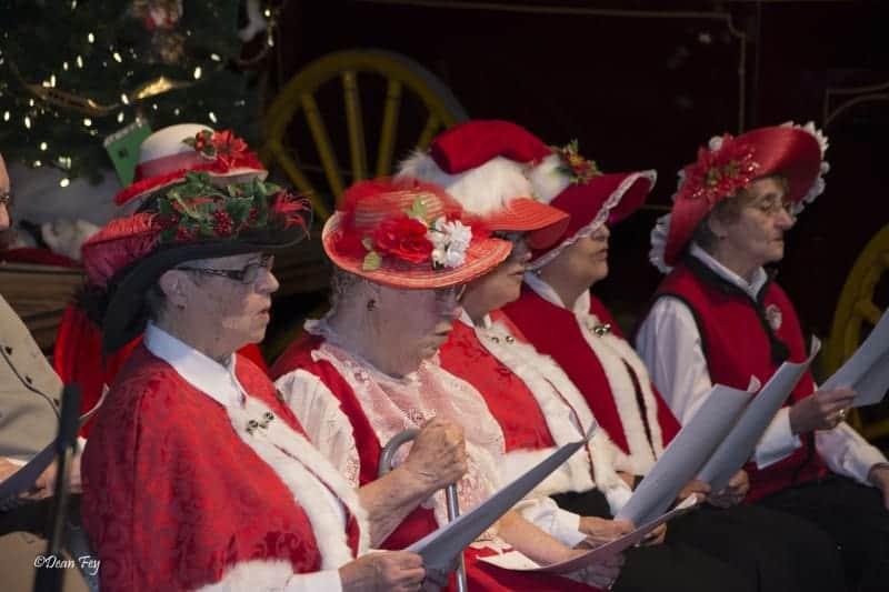 Ladies singing Christmas carols
