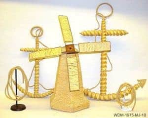 Two boat anchors and a small windmill, all made out of wheat weaving
