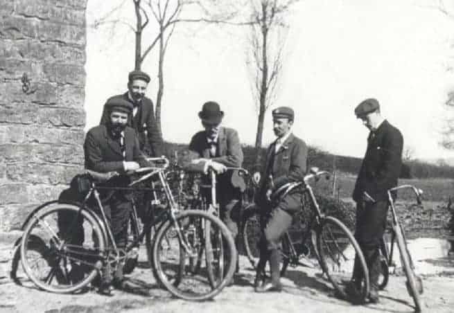 Black and white photo of men with bicycles - an example of human-powered transportation