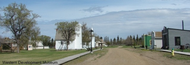 Heritage village street, showing two churches