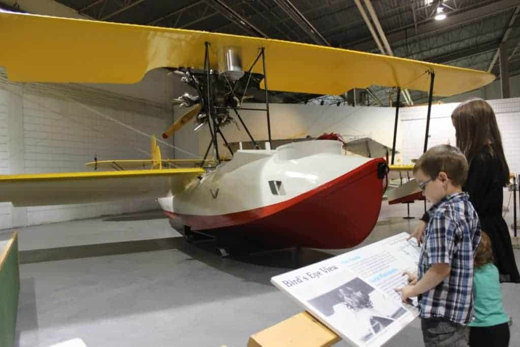 "Completed Vickers Vedette ""flying boat"" aircraft recreation, being admired by two young children"