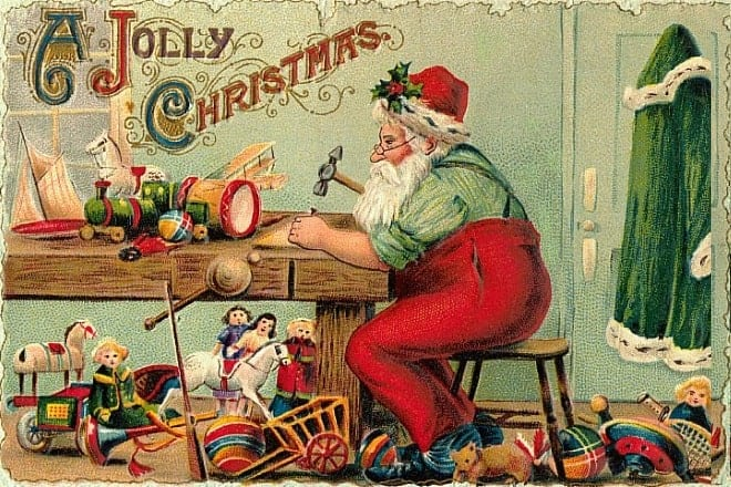 """Vintage Christmas card with the words """"A Jolly Christmas"""" and featuring Santa in his toy workshop, surrounded by toys"""