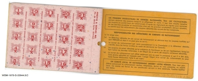 World War II ration book 6, open to inside pages showing ration coupons and listing book holders' responsibilities