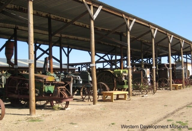 Tractors and other equipment in a pole shed in Yorkton.