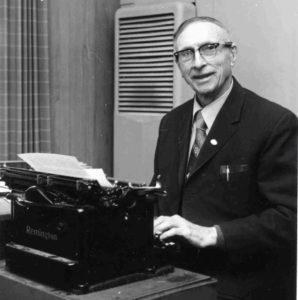 George Shepherd typing on typewriter