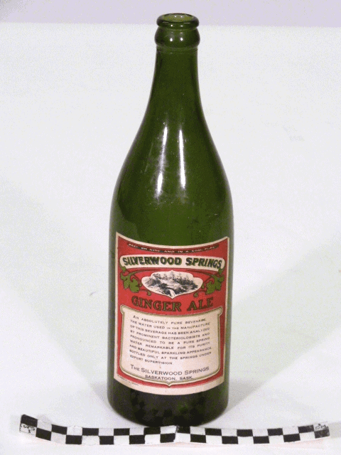 Green glass bottle with predominantly red Silverwood Springs label